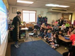 3rd graders had a special presentation today from foreign exchange students Slava, Nurzhamal and Muslim. Our international students educated 3rd graders on their culture, local traditions, language, music, and food.