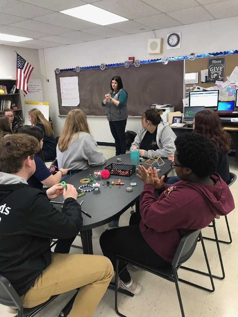 Students play with fidgets while they listen to Christine Heaverly